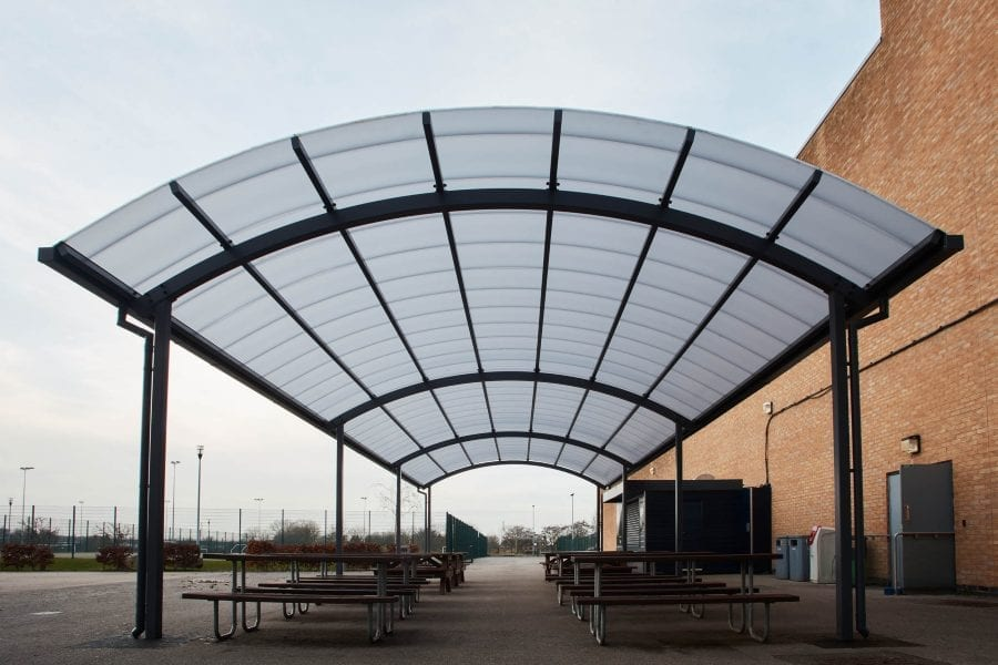 Curved roof dining canopy we designed for Blessed John Henry Newman College