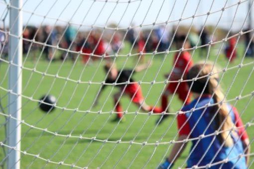 School children playing football