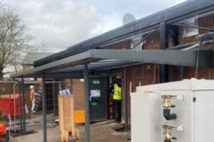 Straigt roof canopy we designed for Murdishaw Co-op