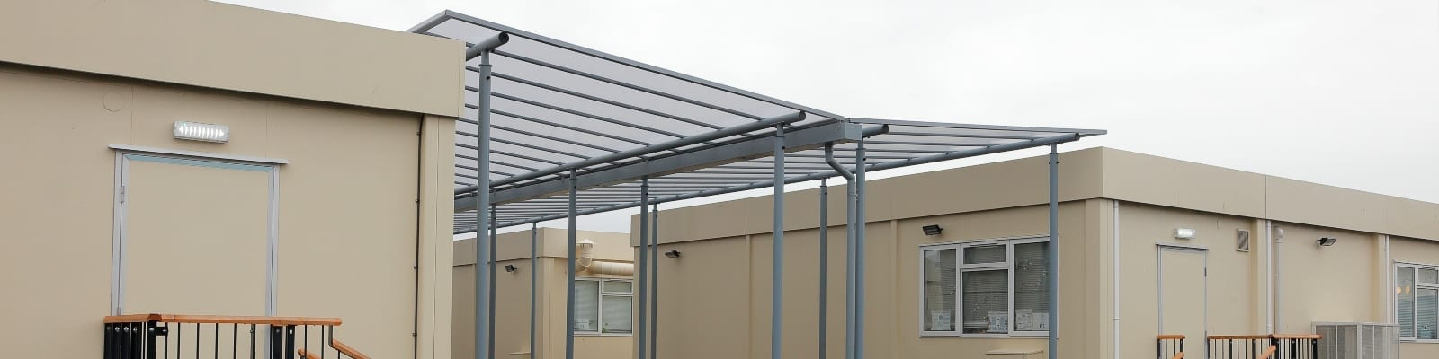 Newman School Straight Roof Shelters