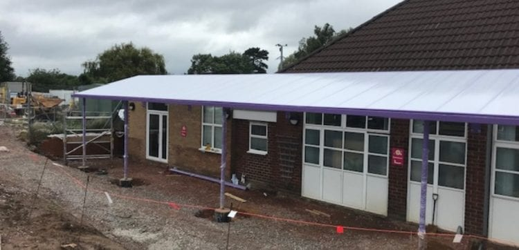 Purple frame canopy we designed for Finlay School