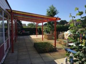 Colourful shelter we designed for Ranvilles Infant School