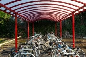 Curved roof cycle shelter we designed for Myton School