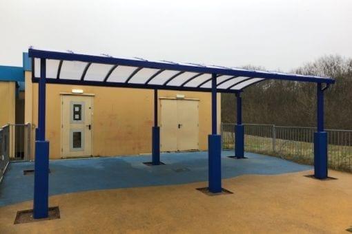Blue shelter we designed for Bettws Flying Start Playgroup