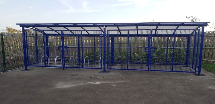 Blue cycle shelter we made for Riverside Bridge School