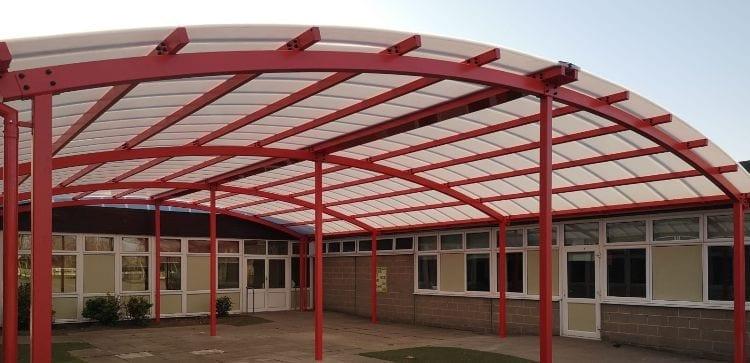 Red shelter we designed for Woodlands Primary School