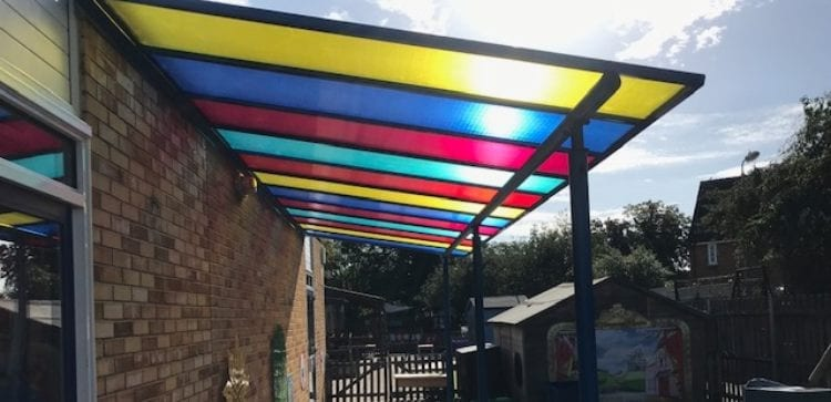 Colourful polycarbonate roof shelter at Hatfield Peverel School