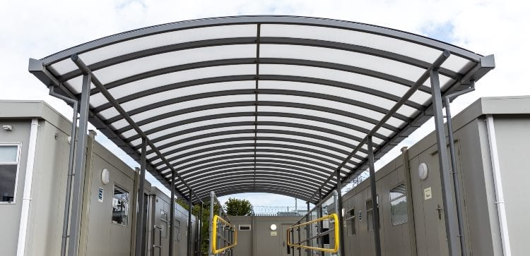 Curved roof shelter we made for Dorset Waste Centre