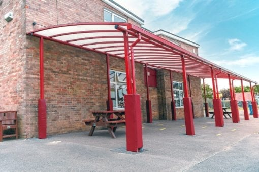 Curved roof playground shelter we made for Covingham Park Primary School