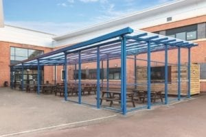 Outdoor dining Aarea shelter we designed for Avon Valley School