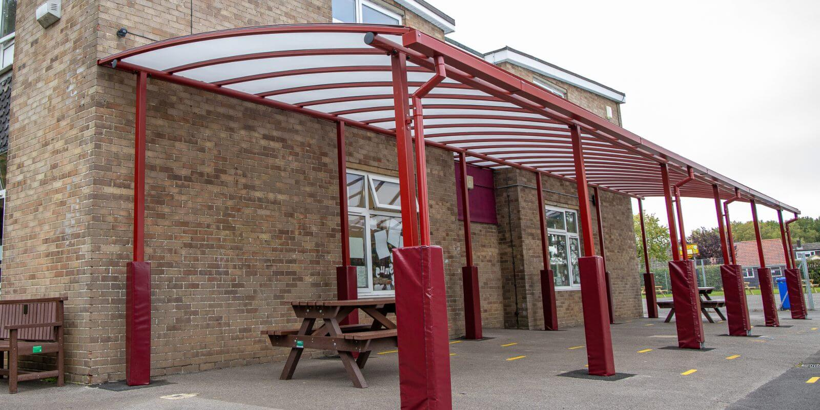 Curved roof playground shelter at Covingham Park Primary School