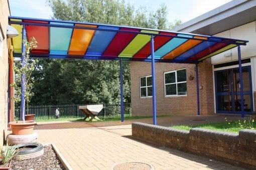 Colourful shelter we designed for Billing Brook Academy