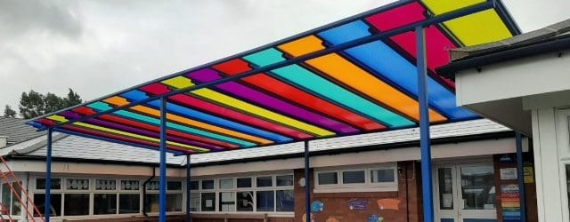 Multicoloured polycarbonate roof canopy we designed for Old Church Primary School
