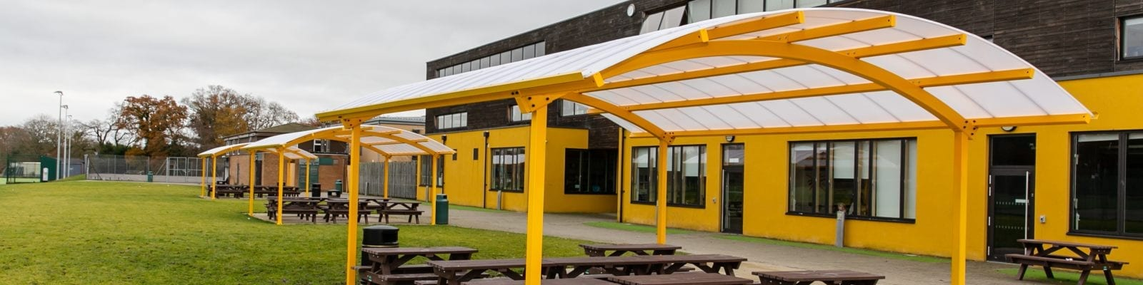 Curved roof shelters we fitted at Waingels College