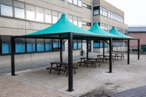 Green tepee canopies we designed for Shooters Hill College