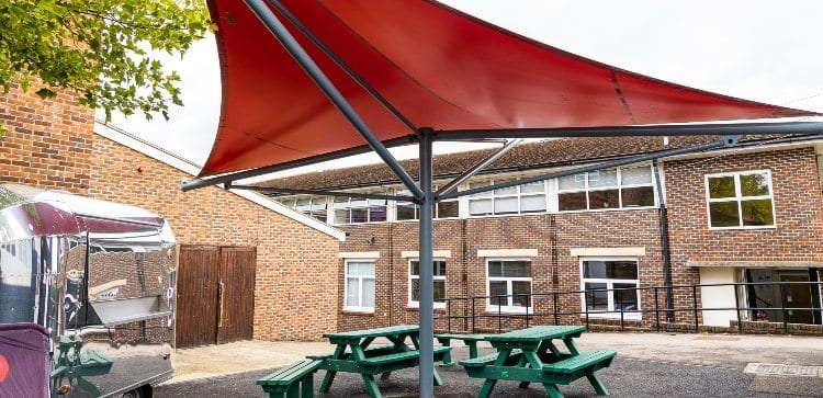 Red fabric shelter we installed for Hillview School for Girls
