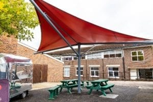 Red fabric shelter we manufactured for Hillview School for Girls
