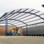 Curved roof shelter we added to The Corbet School