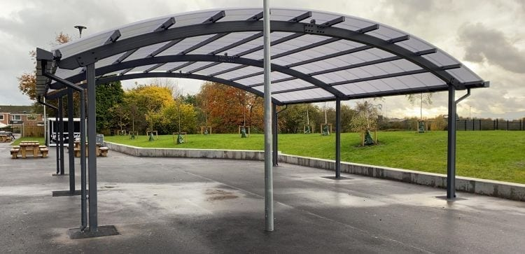 Curved roof shelter we installed at Laurus Ryecroft School