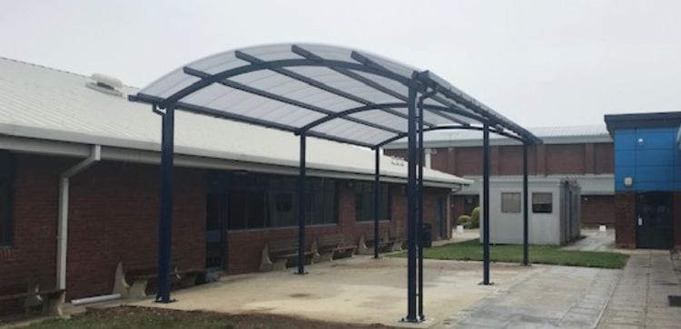Curved roof canopy we installed at Sir Thomas Rich's School