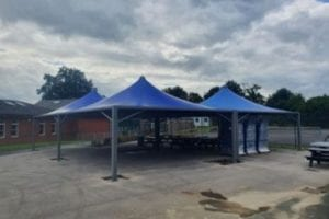 Fabric shelters we installed at Bishop Heber High School