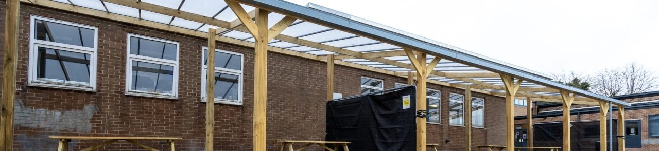 Timber playground shelter we installed at Handsworth Wood School
