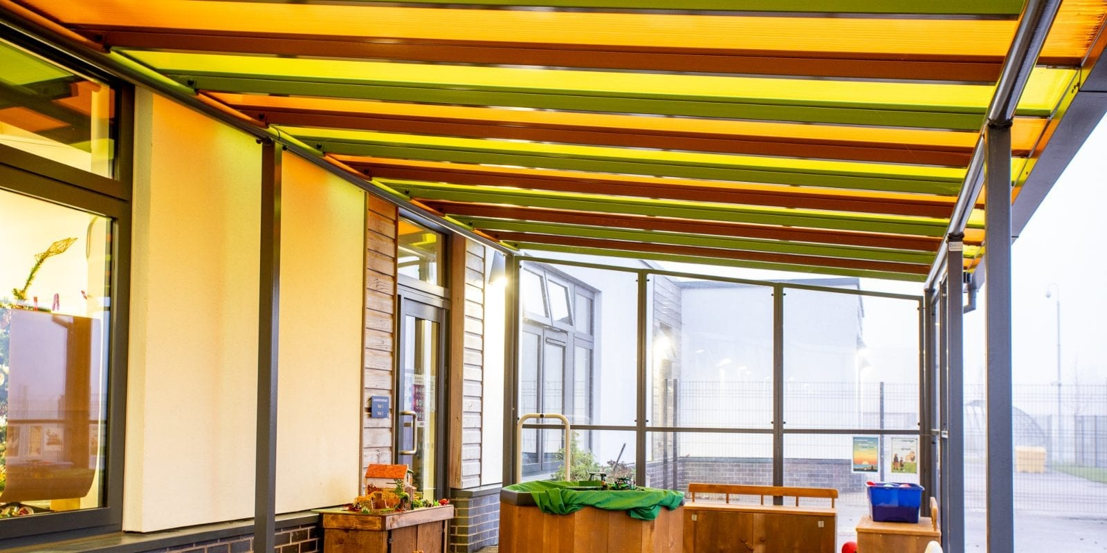 Coloured roof canopy we designed for Monksmoor Park Primary School