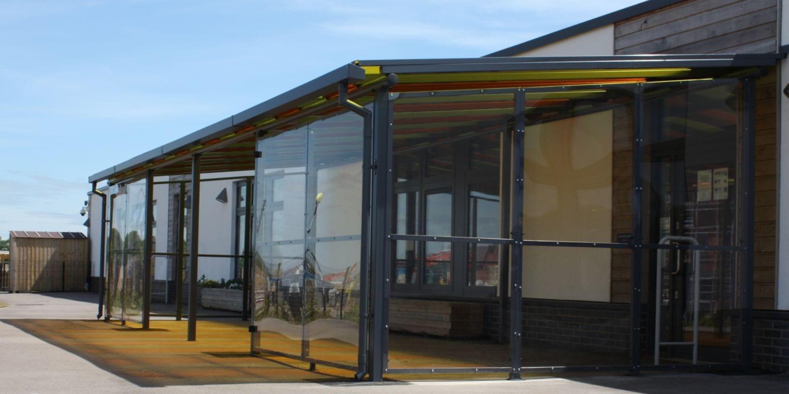 Colourful roof shelter we designed for Monksmoor Park Primary School