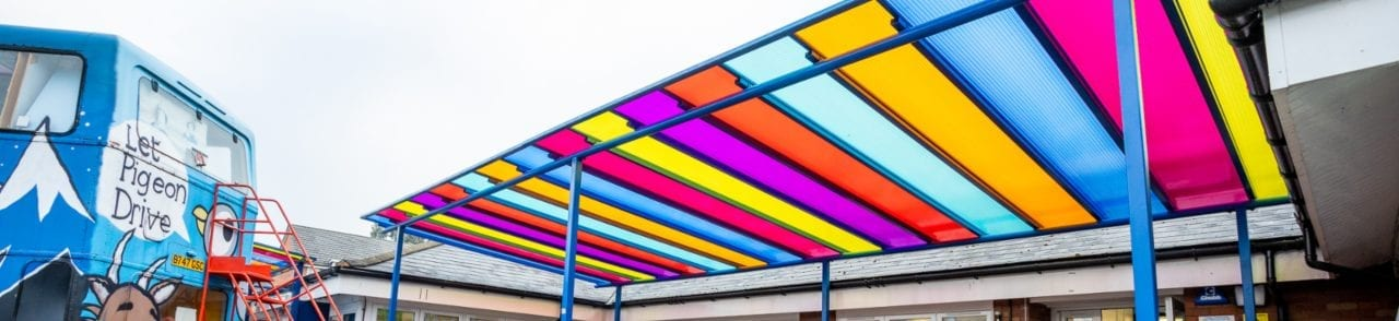 Multicoloured roof shelter we designed for Old Church Primary School