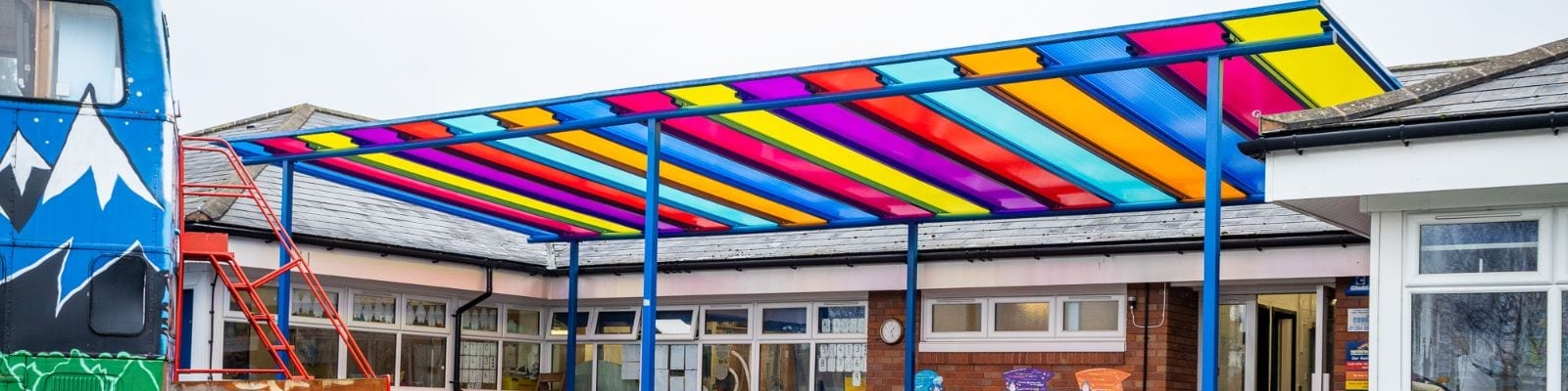 Rainbow roof shelter we designed for Old Church C of E Primary School