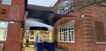 Wall-mounted sail shade we installed at Epsom College