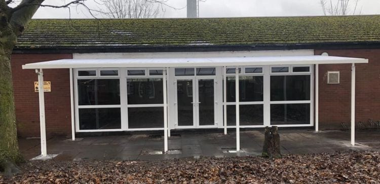 Straight roof shelter we installed for Mothers Against Violence