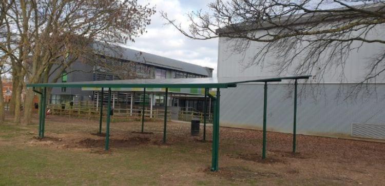 Straight roof shelter we designed for Uxbridge High School
