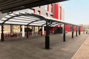Curved roof shelter we installed at Dean Trust Ardwick