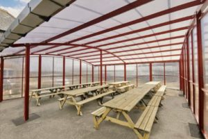 Cuvred roof shelter we designed for Poltair School