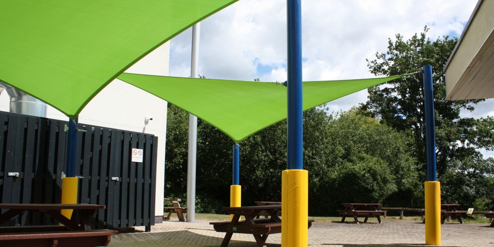 Green shade sail we installed at South Gloucester College