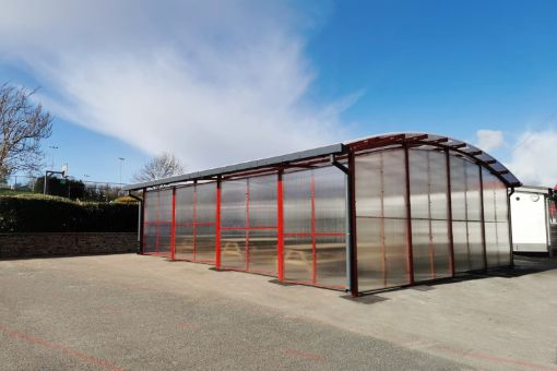 Red dining shelter we fitted at Poltair School