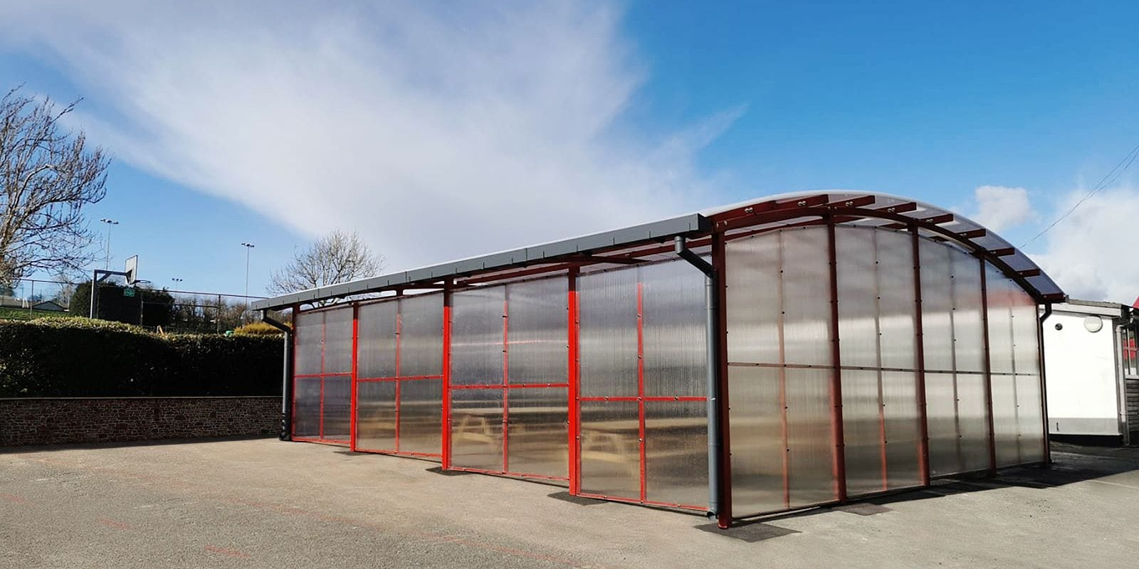 Red dining shelter we made for Poltair School