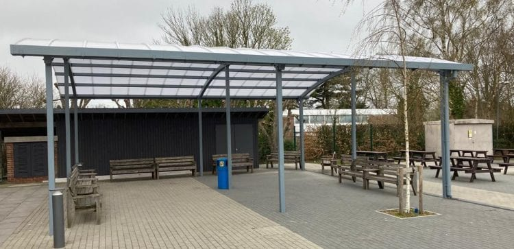 Curved roof shelter we installed at Wye School