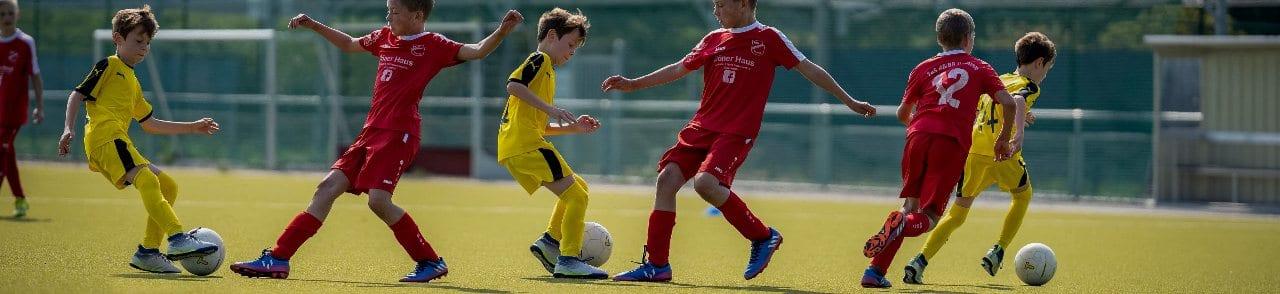 Children Learning Football
